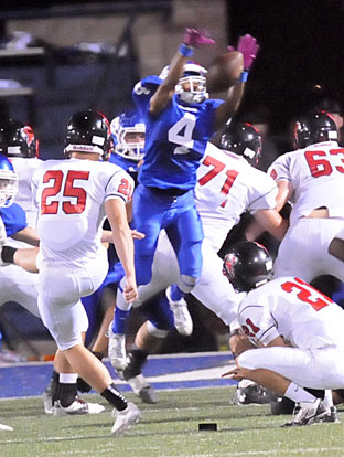 Mark Nelson (4) blocks a field goal attempt. (Photo by Kevin Nagle)