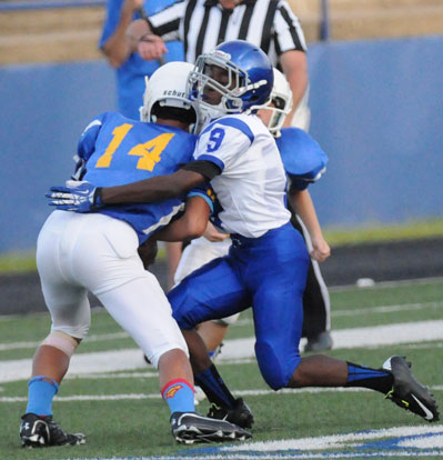 Bethel's Sebastian Dunn makes a tackle. (Photo by Kevin Nagle)