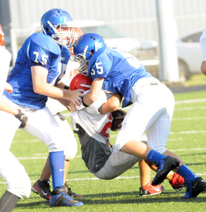 Jakob Neel (55) and Blaise Smith (75) get in on a tackle. (Photo by Kevin Nagle)