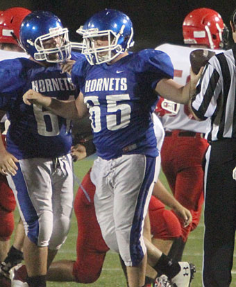 Hunter Howard (65) hands the ball to the referee after recovering a Cabot South fumble. (Photo by Rick Nation)