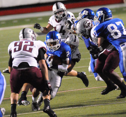 Brushawn Hunter (2) looks to get past Benton's Dylan Murphy (92). (Photo by Kevin Nagle)