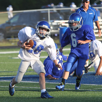 Bryant White's Damien Constanino (28) is pursued by Bryant Blue's River Holland (6). (Photo by Rick Nation)