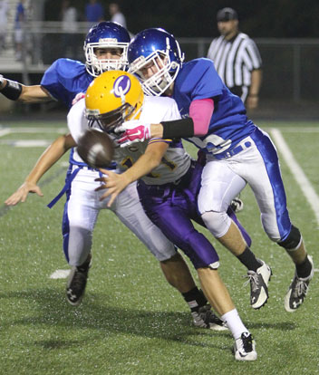 Bryant's Cameron Vail (5) knocks the ball loose as he hits Catholic quarterback Nathan Page. (Photo by Rick Nation)