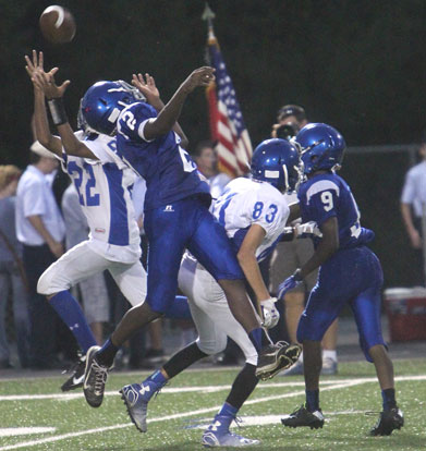 Bryant White's Andrew Hayes (22) hauls in a touchdown pass over Bryant Blue's Randy Thomas (2) and Sebastian Dunn (9) as well as teammate Clift Chaffin. (Photo by Rick Nation)
