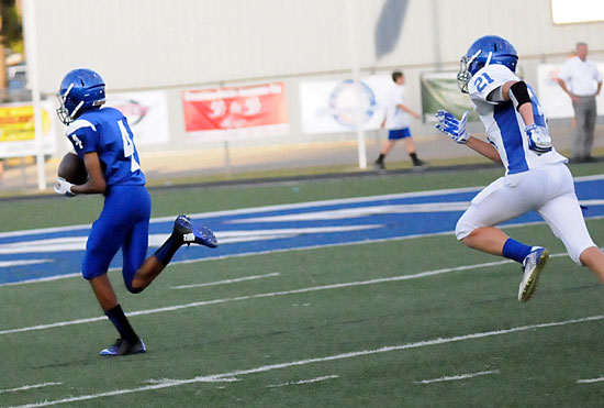 Josh Robinson (4) heads toward the end zone with Grant Botti (21) in pursuit. (Photo by Kevin Nagle)