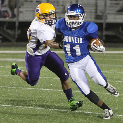 Diante Woodson evades a Catholic defender. (Photo by Rick Nation)