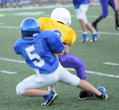 Cameron Scarlett makes a tackle after a Horace Mann pass completion. (Photo by Kevin Nagle)