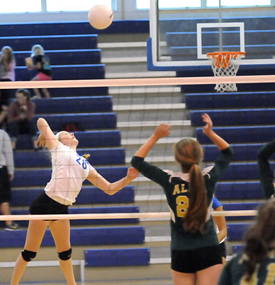 Reagan Blend (28) goes up for a hit. (Photo by Kevin Nagle)