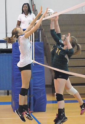Emily Clem goes up for a block. (Photo by Kevin Nagle)