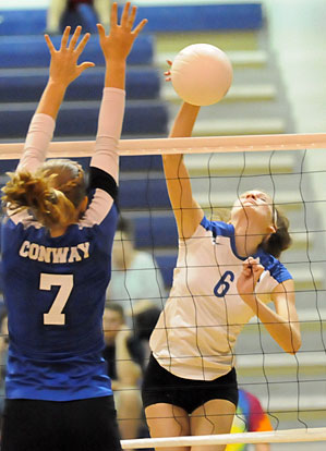 Allie Anderson (6) tries to get a hit past a Conway defender. (Photo by Kevin Nagle)