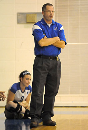 Bryant coach Lawrence Jefferson watches the action with junior Kendall Selig. (Photo by Kevin Nagle)