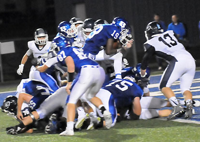 Kylon Boyle steps into the end zone over the pile at the line of scrimmage. (Photo by Kevin Nagle)