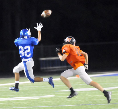 Jalen Hernandez (32) hauls in a pass in front of a Malvern defender. (Photo by Kevin Nagle)