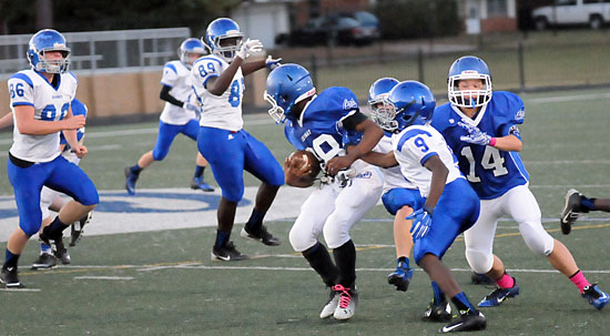 Johnny Smith (9) turns back Conway White running back Eddie White as Bethel defenders Michael Chatman (89) and Patrick Karp (86) pursue. (photo by Kevin Nagle)