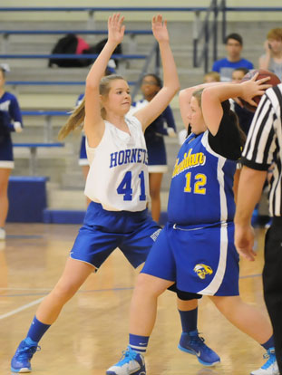 Kinley Oholent (41) defends against a Sheridan player during Tuesday's seventh grade girls game. (Photo by Kevin Nagle)