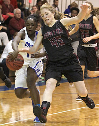 Lauren Carroll (11) steals the ball from Benton's Bayley Landreth (45). (Photo by Rick Nation)