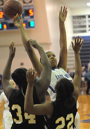 Raven Loveless (25) finished with 7 points and 10 rebounds. (Photo by Kevin Nagle)