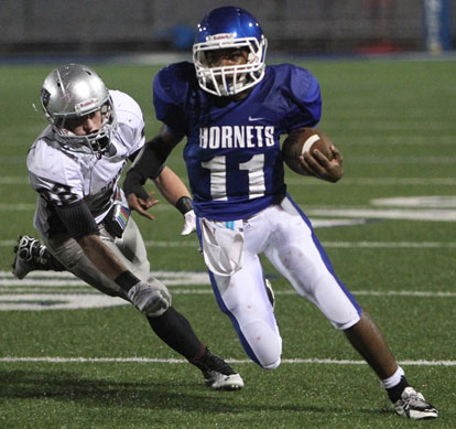Diante Woodson rushed for 120 yards and a touchdown Tuesday night. (Photo by Rick Nation)