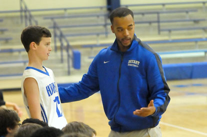 Bethel coach Dominic Lincoln talks with one of his players before putting him in the game. (Photo by Kevin Nagle)