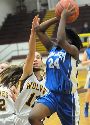 Kalia Walker finishes off a drive. (Photo by Kevin Nagle)
