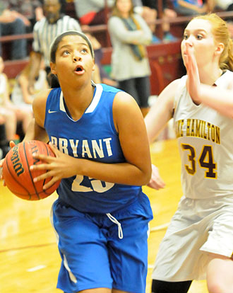Raven Loveless (24) makes a move to the basket. (Photo by Kevin Nagle)