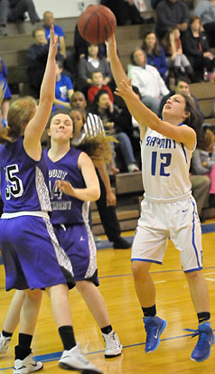 Bryant's Maddie Baxter (12) shoots over Mount St. Mary defenders Lizzie Allgood (35) and Allie Walls (14). (Photo by Kevin Nagle)
