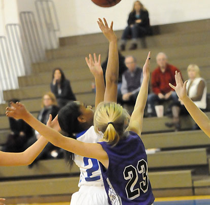 Destiny Martin (2) gets a shot away in traffic. (Photo by Kevin Nagle)