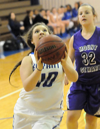 Morgan Walters drives to the basket. (Photo by Kevin Nagle)