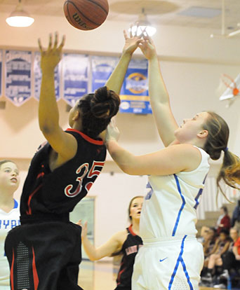 Anna Turpin, right, tries to get a shot over Russellville's Maliyah Franklin. (Photo by Kevin Nagle)