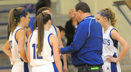 Bethel coach Derek McGrew meets with his team during a timeout. (Photo by Kevin Nagle)