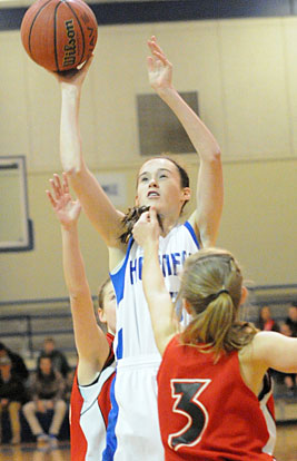 Mary Catherine Selig reaches hit to get a shot away. (Photo by Kevin Nagle)