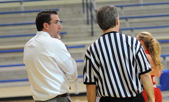Bryant coach Nathan Castaldi discusses a call with one of the officials in Thursday night's game. (Photo by Kevin Nagle)