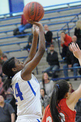 Jasmine Daniels (24) contributed a key basket in the fourth quarter. (Photo by Kevin Nagle)