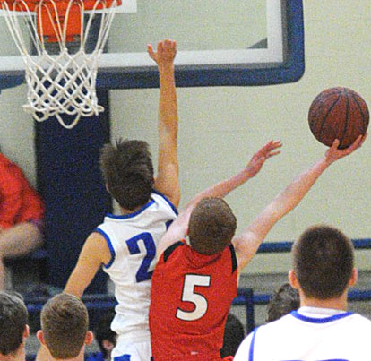 Bryant's Brandon Hill (24) tries to block a shot by Cabot South's Jared Vance (5). (Photo by Kevin Nagle)