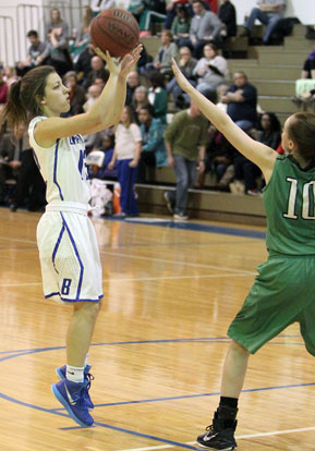 Maddie Baxter (12) takes aim at a jumper as Kaylee Sheppard defends for Van Buren. (Photo by Rick Nation)