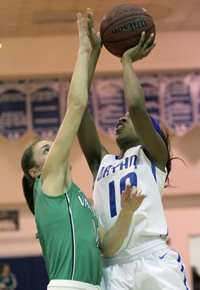 Bryant's Jakeira Otey (10) tries to get a shot up over Van Buren's Kaylee Sheppard. (Photo by Rick Nation)