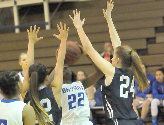 Taylor Hill (22) looks to shoot in a crowd. (Photo by Kevin Nagle)