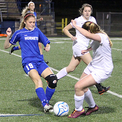 Bryant's Natalie Pierce (19) battles for possession of the ball. (Photo by Rick Nation)