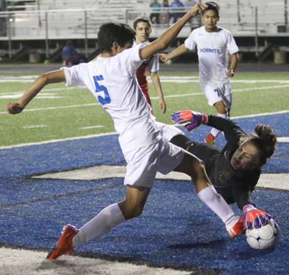 Ricky Barrientos attacks the Cabot keeper. (Photo by Rick Nation)