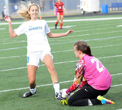 Anna Lowery confronts the Cabot keeper. (Photo by Kevin Nagle)