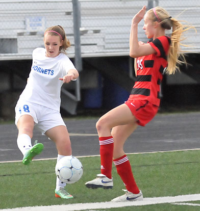 Ashlie Sparks (18) gets the ball past a Cabot player. (Photo by Kevin Nagle)