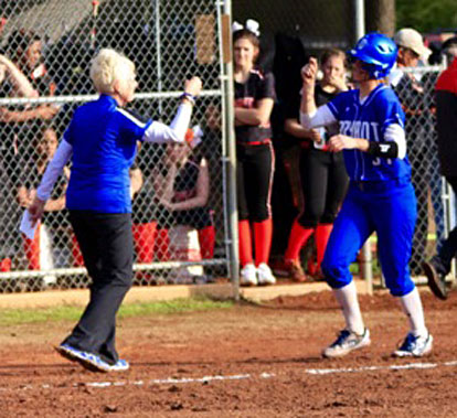 Lady Hornets coach Debbie Clark congratulates Cayla McDowell after her home run. (Photo courtesy of Jon Staton)