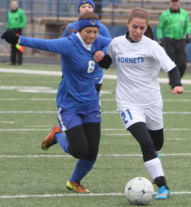 Allison Hughes, right, battles past a Valley View defender. (Photo by Rick Nation)