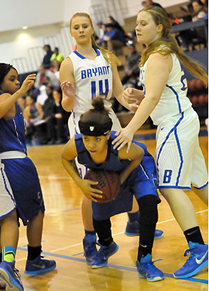 Bryant's Riley Hill (14) and Anna Turpin defend as a Conway player tries to escape. (Photo by Kevin Nagle)