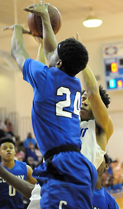 Rickie Allen meets Conway's Tyler Smith (24) on the way to the hoop. (Photo by Kevin Nagle)