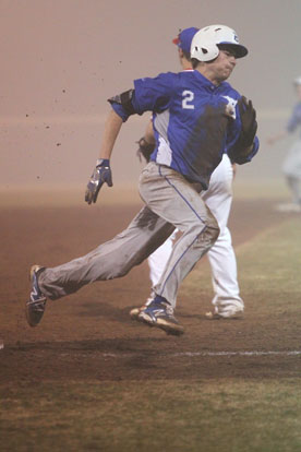 Evan Lee rounds third and heads for home on Blake Patterson's fog-bound triple. (Photo by Rick Nation)