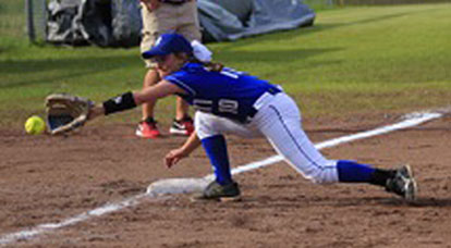 Abby Staton reaches for a ground ball down the line. (Photo courtesy of Jon Staton)