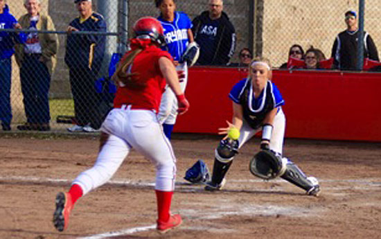 Bryant catcher Julie Ward tries to field a throw as a Vilonia base-runner bears down on her. (Photo courtesy of Jon Staton)