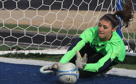 Maddie Hawkins saves a PK during Monday's shootout. (Photo by Rick Nation)