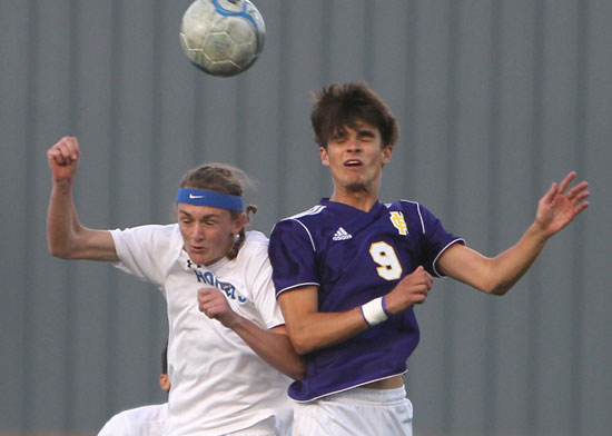 Logan Moore, left, goes up for a contested header. (Photo by Rick Nation)